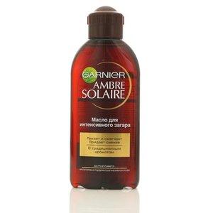 Традиционное масло для интенсивного загара Garnier Ambre Solaire (Гарньер Амбре Солер) для очень смуглой уже загорелой кожи ТМ Garnier